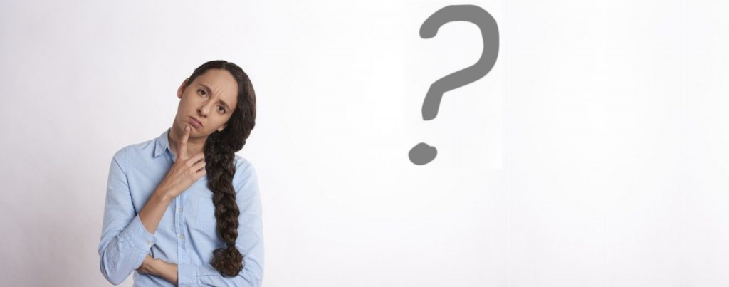 woman with brown hair having a confused look with a question mark in the background
