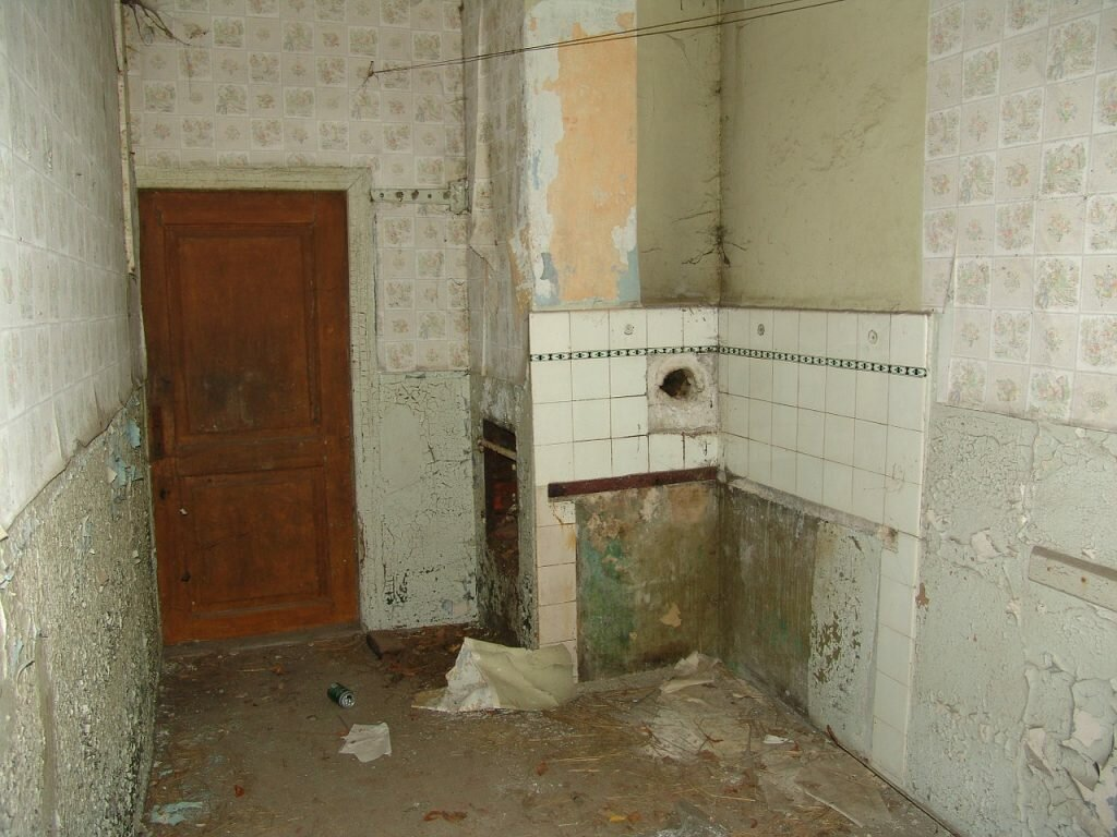 interior of bathroom that needs a significant amount of repairs