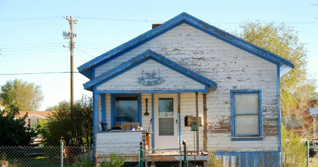 a house that has lots of maintenance needs and peeling paint