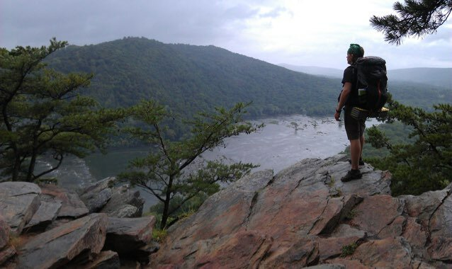 Aaron enjoying the view from the trail on a local backpacking trip.