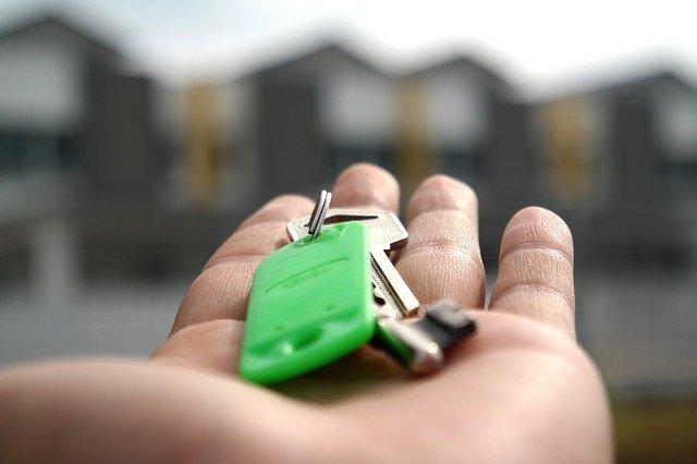 Man holding keys for owner financing in Houston