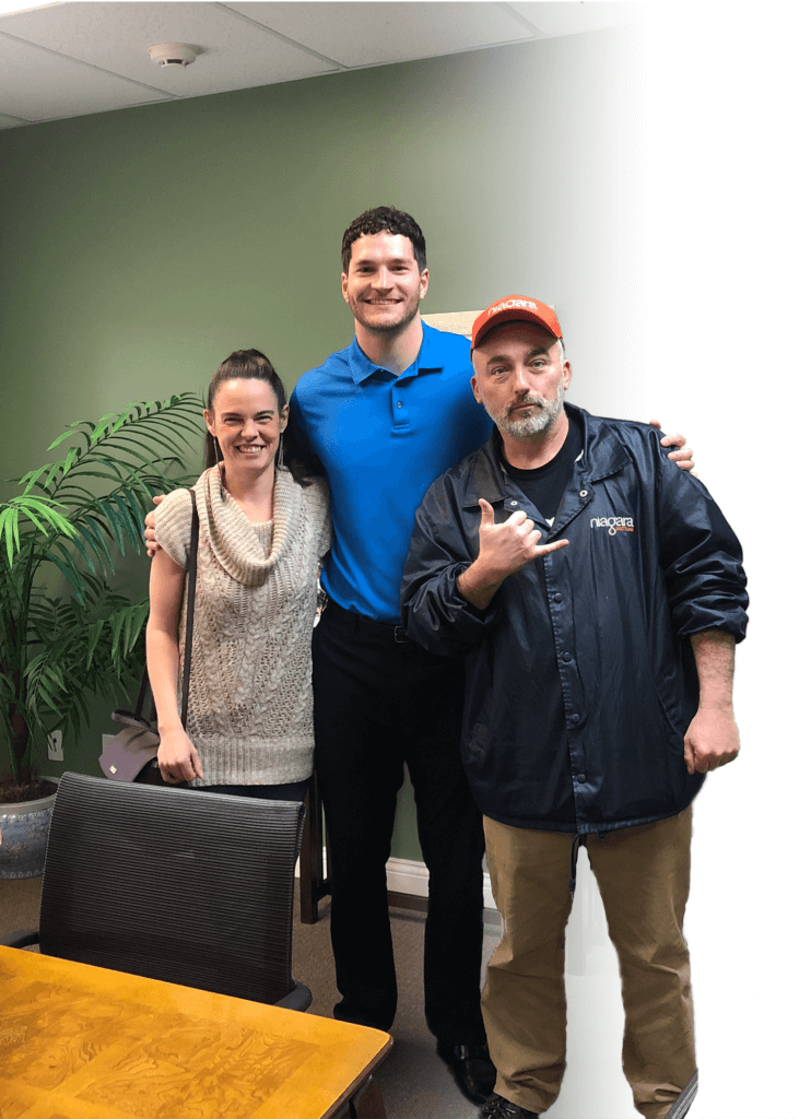 Paul Logsdon with some happy home sellers