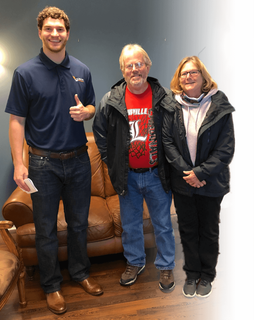 Paul Logsdon with happy home sellers