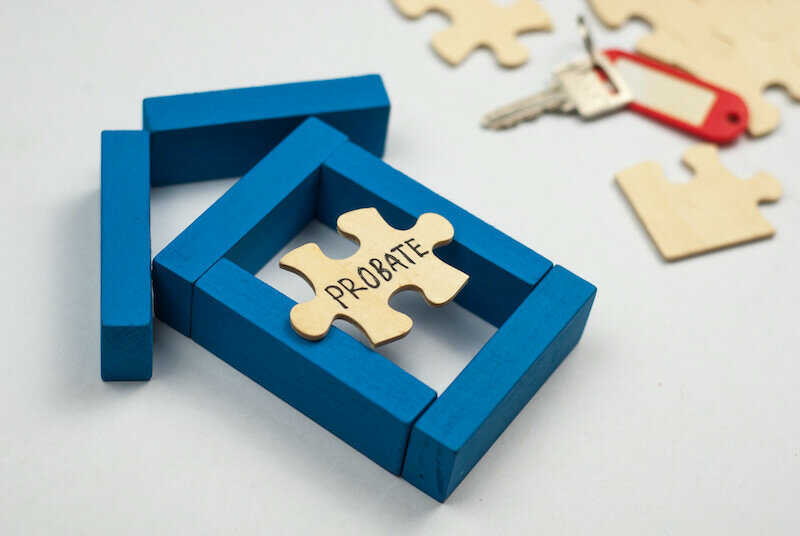 Model house made from wooden block and wooden puzzle with text probate on white background