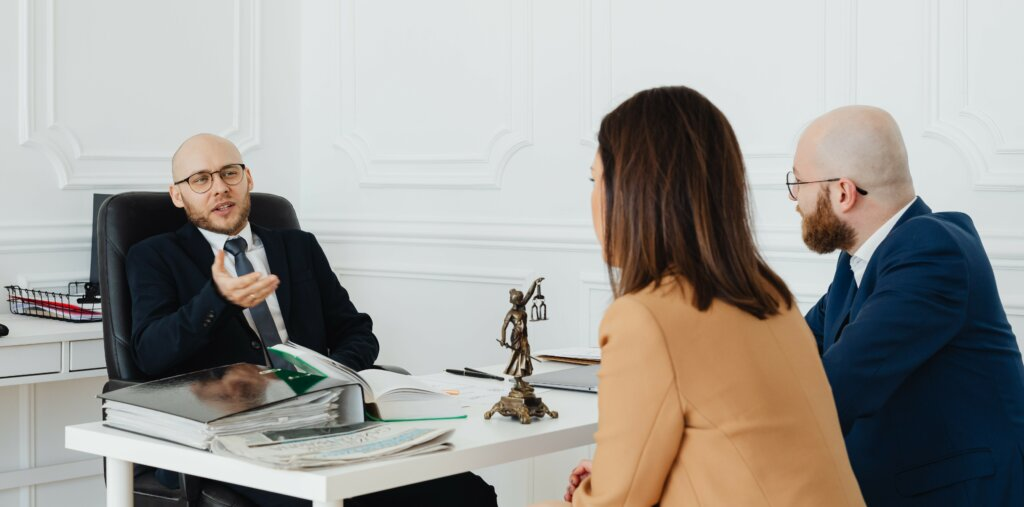 divorcing couple consulting a divorce lawyer on what to include in their divorce decree