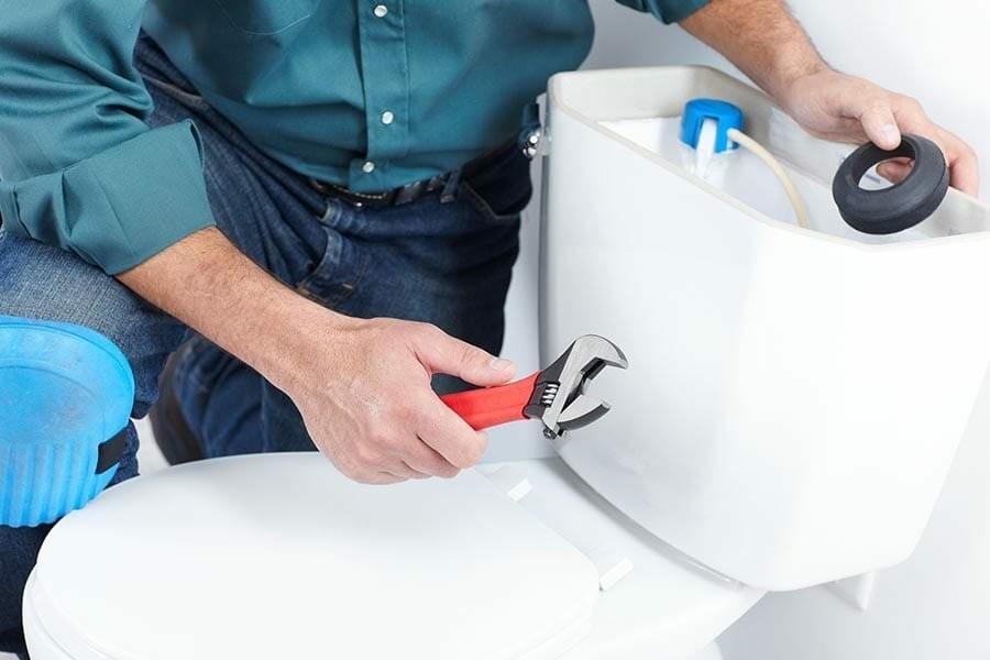 man repairing the water tank