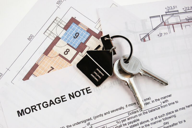 Keys on mortgage note and blueprints