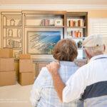 Senior couple hugging looking at packing their belongings.