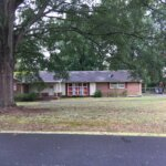 Ranch House with Large Oak Tree in Front Yard