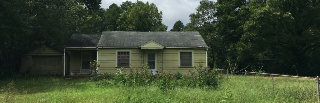 Small Charlotte House that needs to be repaired.