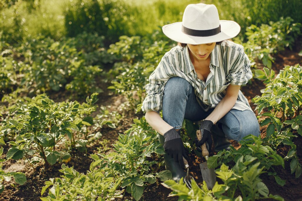 female homeowner tending to your garden before selling her house