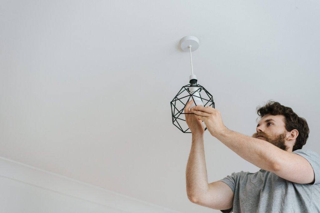 installing energy efficient light bulbs