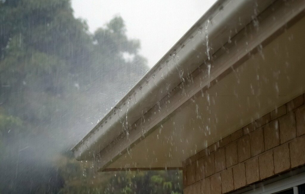 gutters with rain dripping
