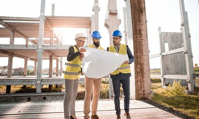 construction workers reviewing site plans at a job site