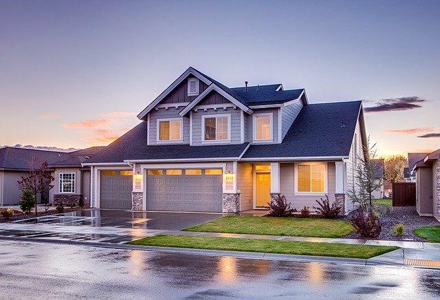 Nice 2 story home on a rainy street at dusk