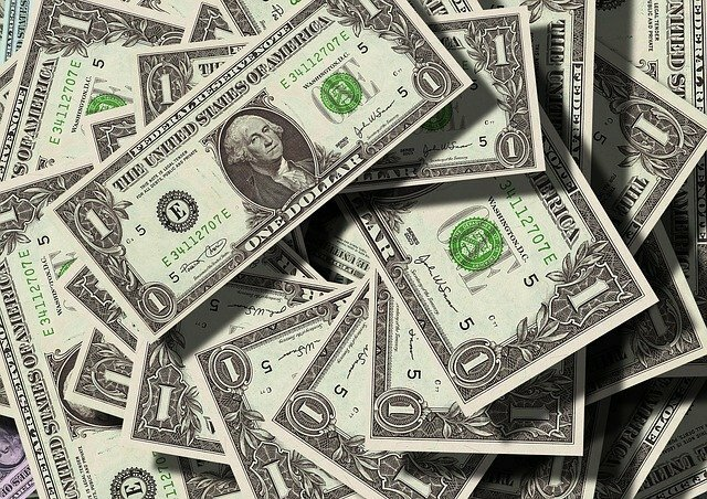 stack of scattered one dollar bills