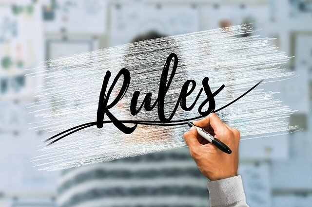 Rules written in cursive on a clear background