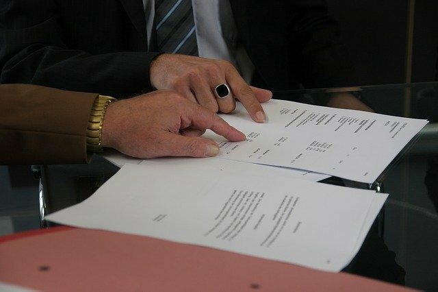two people signing a rent to own agreement