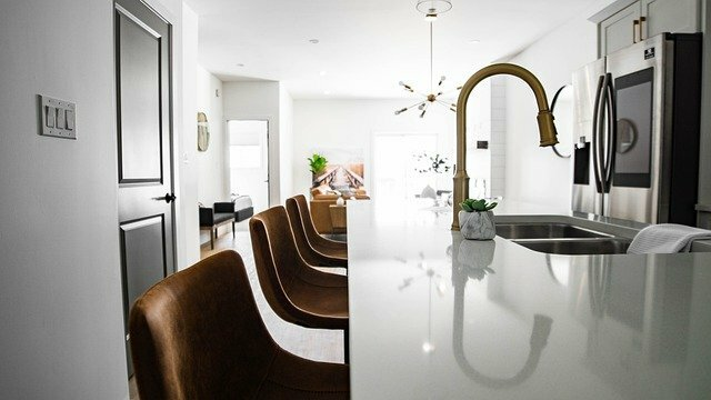 white interior kitchen with gold faucet