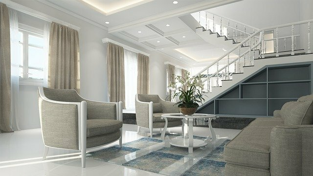 modern interior home with white walls, white floors, and white table