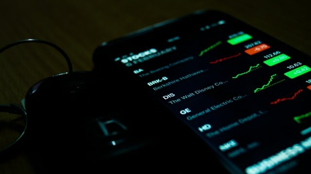 stock prices on a smartphone screen