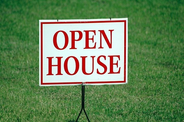Open House Sign in green grass