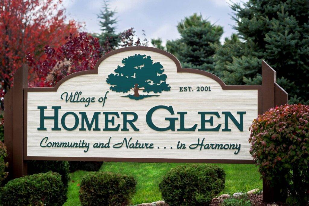 We buy houses Homer Glen village sign.