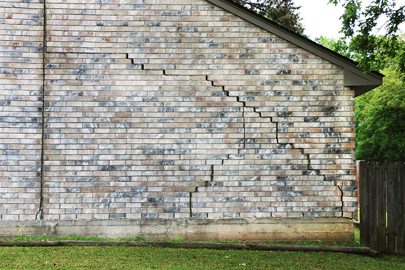 House with foundation problems and cracks in the brick