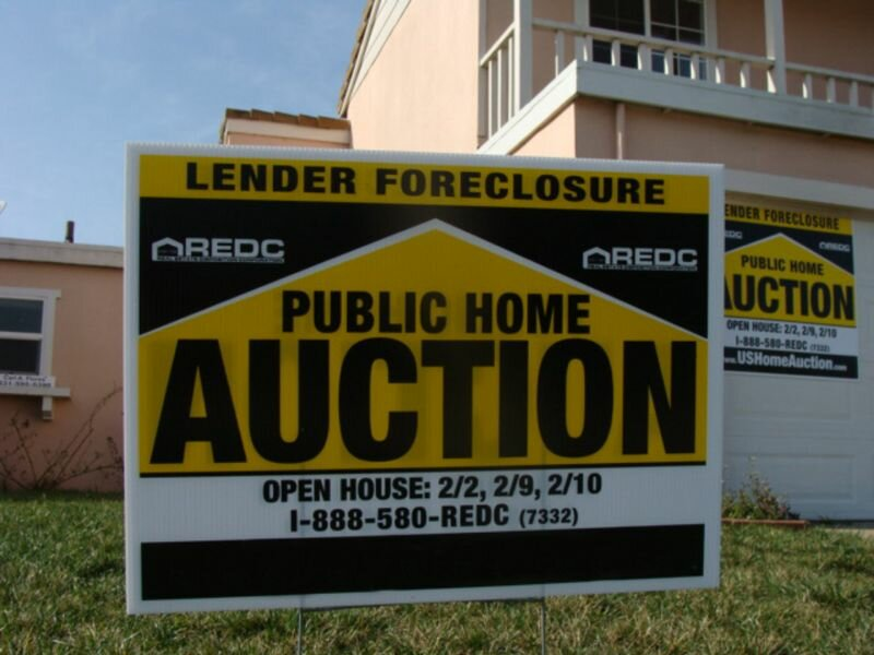 A Sign Advertising a Foreclosure Auction