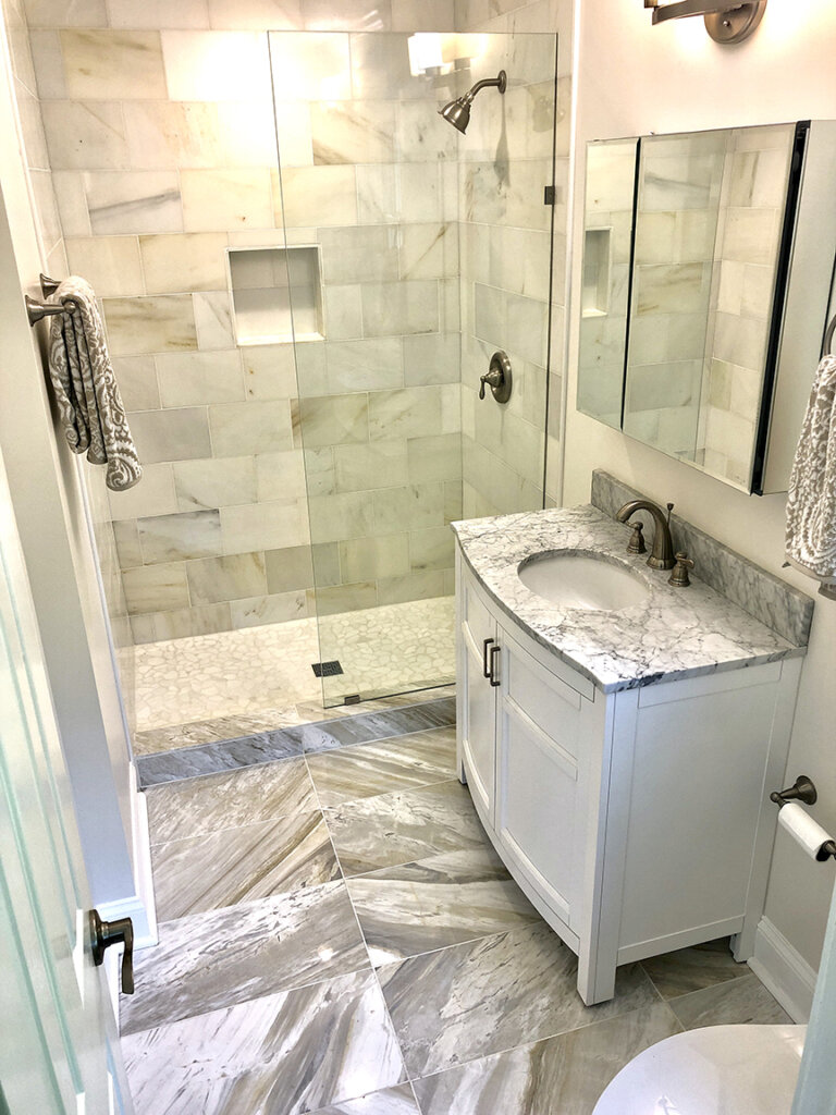 Remodeled bathroom by Helpful Homes after a fast cash purchase in Greensboro North Carolina. We buy houses for cash today. Buy my house in greensboro.