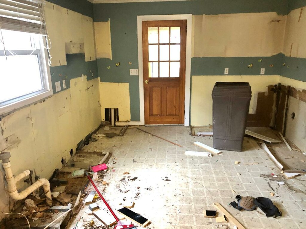 We Buy Houses Fast for Cash in greensboro, this is a before picture of the kitchen after Helpful Homes purchased this house for cash.