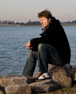 """Man sitting on the coast thinking, """"sell my house fast to The Aida Group.com"""