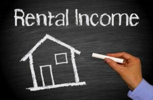 Generate monthly income through real estate investment properties