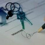 Signing a contract to sell a house