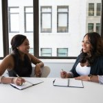 two women talking ovreal estate transaction