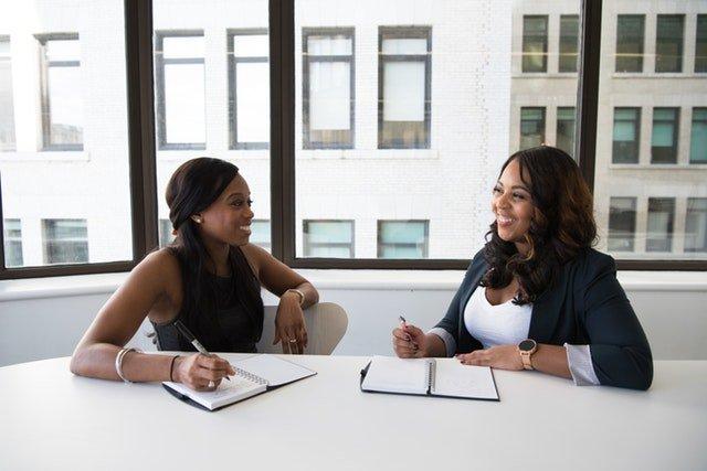 two women talking ovreal estate transaction