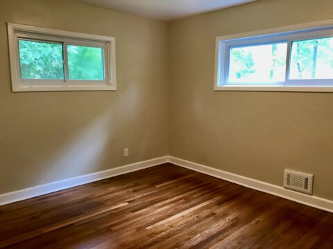 Gleaming wood floors, privacy windows