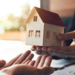 Hands turning over a small house from buyer to seller