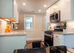 Kitchen after Modern Redeveloper Home Buyers rehabbed the house