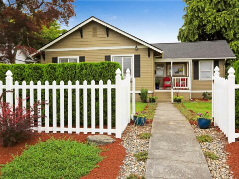 house exterior with picket fence
