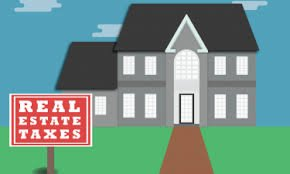 who pays real estate taxes on an inherited house