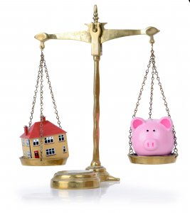 cost of selling house | Piggy Bank and house scale | PAD Home Buyers