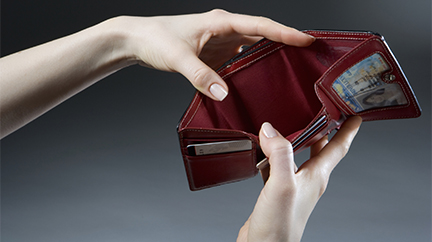 Woman holding empty wallet, close-up of hands