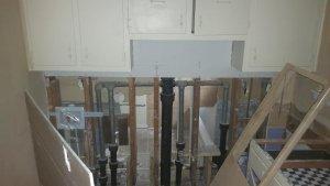 Pre-Reno kitchen to bath wall open