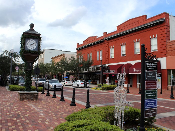 picture-of-an-orange-building-and-black-clock-in-sanford