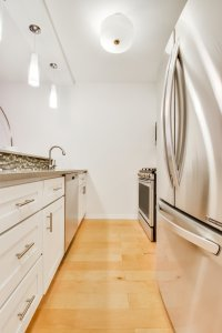 Stainless Steel Appliances Give The Kitchen A Sleek Look.