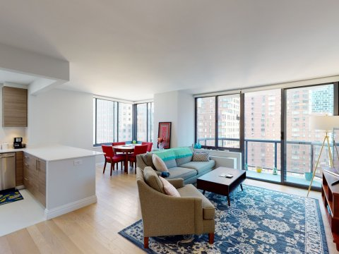 235 W 48th Street Unit 22L Living room, kitchen view from front door of this Times Square adjacent rental apartment.