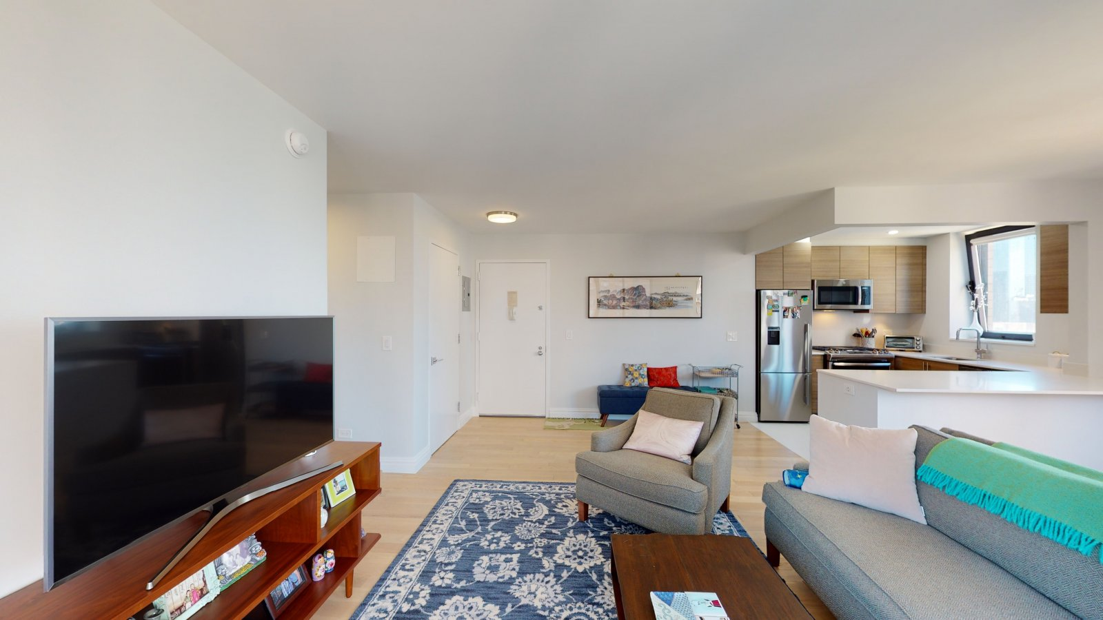 235 W 48th Street Unit 22L Living room and entry foyer of this Times Square adjacent rental apartment.
