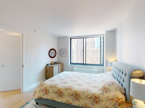 235 W 48th Street Unit 22L Bedroom and Hall views of this Times Square adjacent rental apartment.